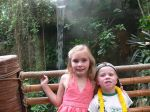 The kids pose in front of the waterfall