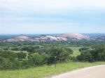 The first view of Enchanted Rock while going north on HWY 965